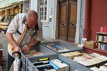 Gregorio rummaging in a secondhand bookshop